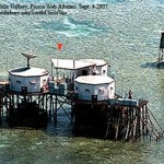 April 1, 1995 photo showing the Chinese national flag above several structures in the Mischief Reef area of the Spratley Islands.